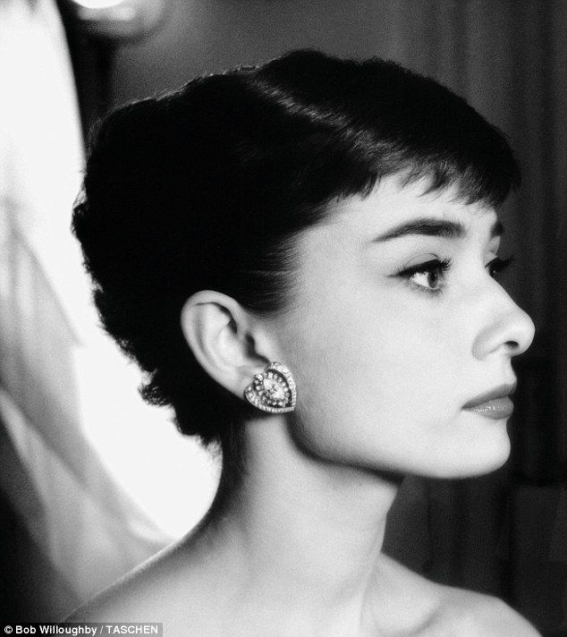 Classic beauty: The star wears striking earrings during a photo session at Paramount Studios in 1953.
