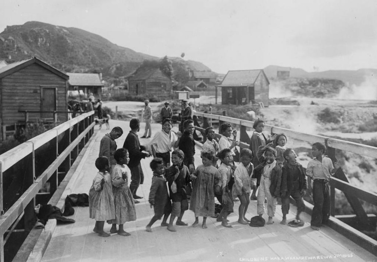 This is so blimmen cute!    In this photograph, tamariki perform haka on the bridge that leads into the famous Māori village at Whakarewarewa, Rotorua.  http://www.hakashows.com/  Josiah Martin, ca. 1881-1912. Alexander Turnbull Library.