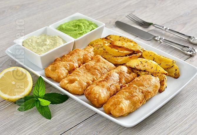 Fish and chips reprezinta unul dintre felurile de mancare preferate ale englezilor si consta in peste pane cu crusta crocanta si cartofi prajiti, la fel de crocanti.