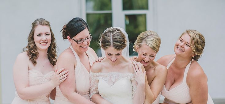Kim's beautiful bridesmaids are wearing Monique Lhuillier in Blush and Slate available at Pearl Bridal House | Photography by Alyssa Alkema
