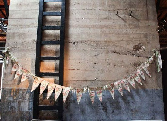 Pictures of Urban and Industrial Weddings  Part of the charm of an industrial space are the cracked, imperfect walls. So work with the space instead of against it by dressing the walls up with sweet simple decor like the DIY bunting garland at this wedding in Texas.