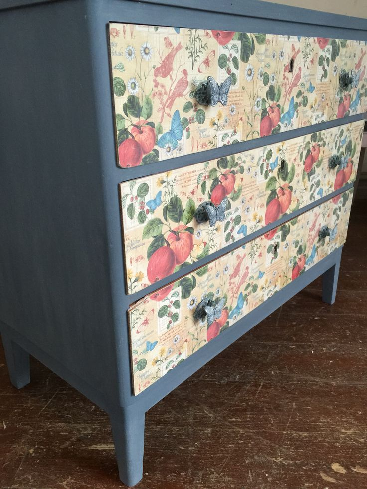 "I painted this with the color ""ocean blue"" Vintage Paint from Jeanne d'Arc Living and i glued scrapbooking paper to the drawers."