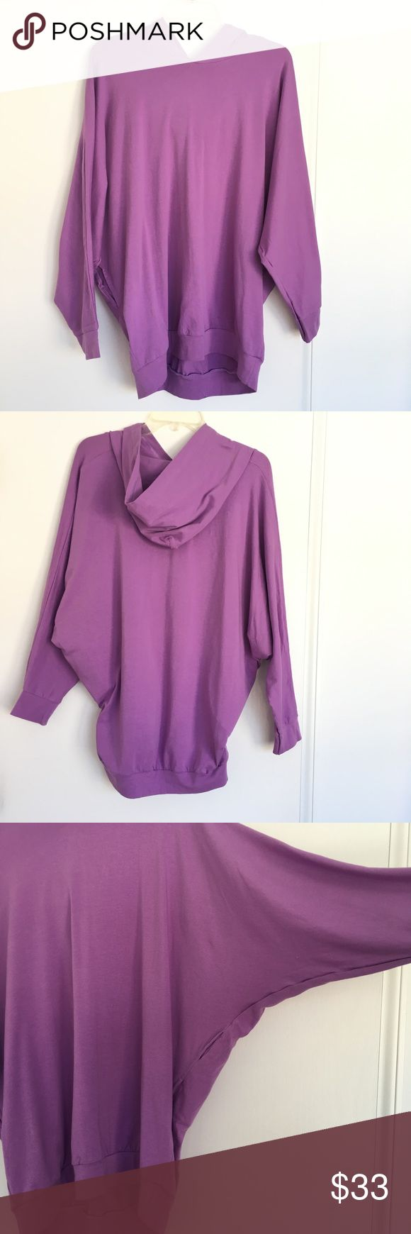 NWT Rare American Apparel Lilac Batwing Hoodie Original American Apparel (before relaunch) batwing hoodie, One Size.   Lightweight, stretchy cotton with dolman sleeves, pockets, and a hood.   For XS to L it would fit loose/oversized. The jersey is quite stretchy!   Small defect- one of the pockets appears to be partly sewn shut, but it's likely possible to undo the stitching. There's also a small yellow spot (see last photo) on the inside of the hoodie near the tags, not visible at all when…