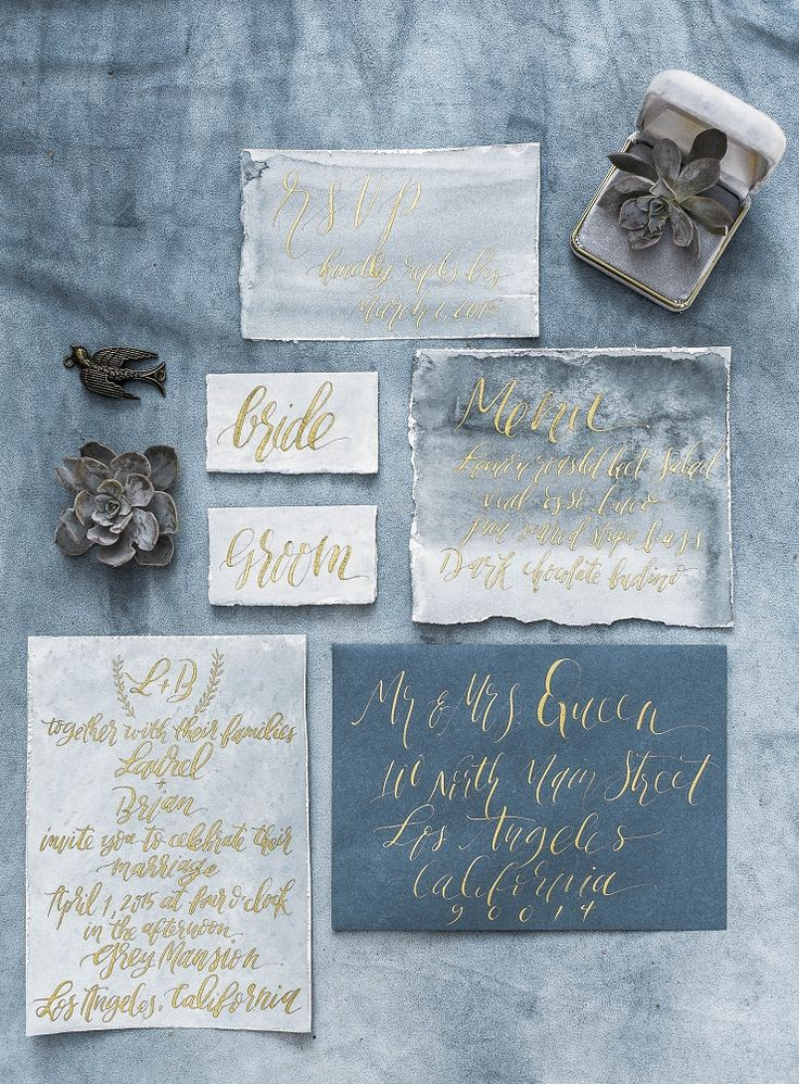 Charcoal blue and gold calligraphy wedding invites