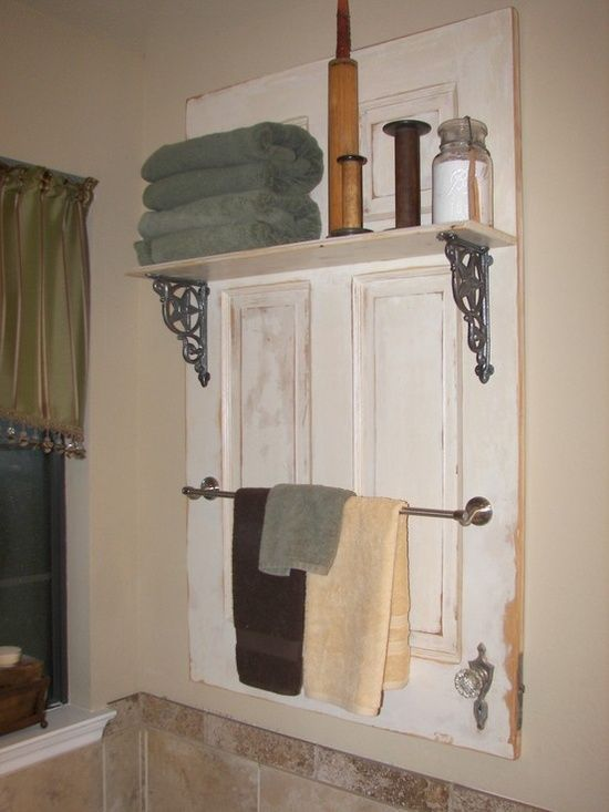 Awesome bathroom decor ~ towel rack and shelf made from an old distressed door ♥