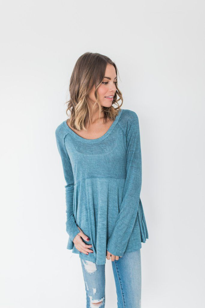 This empire waist flowy swing top captured our hearts right away. Its sweet slit wrist is the perfect detail! 100% Rayon Model is wearing a size small
