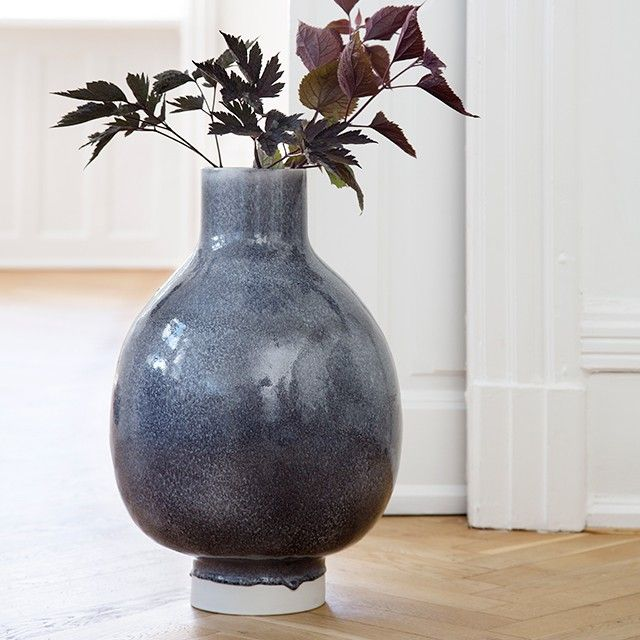 The beautiful heather glaze of the floor vase settles randomly on the ceramics and ends as a heavy drop suspended in time and creates a stunning three-dimensional depth.