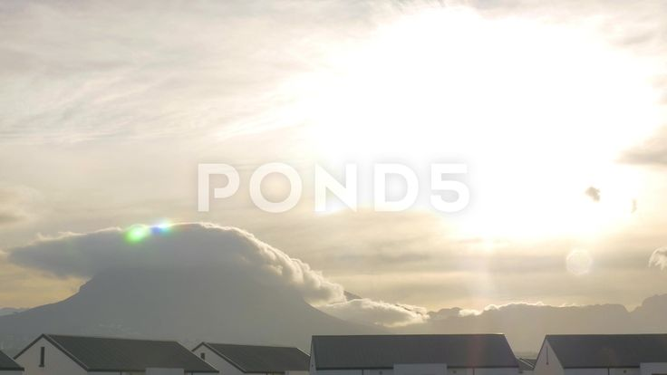 4k Time Lapse Clouds Flow Over Mountain Top Sunlight Lens Flare - Stock Footage | by RyanJonesFilms