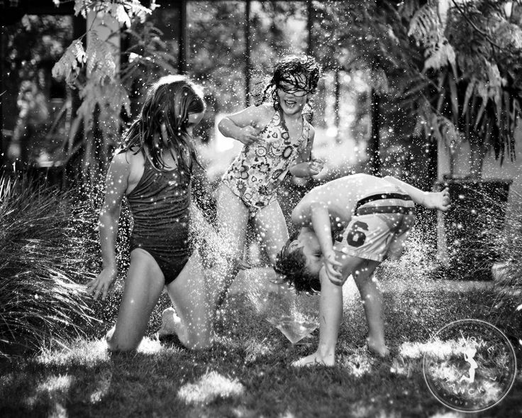I think this is my favourite of all time. The quintessential Aussie childhood. Under the sprinkler in the backyard. © Simone Hanckel Photography