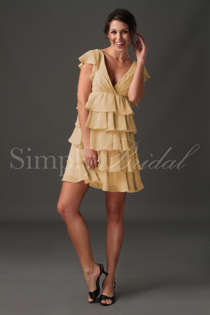 $99Name: #85064 - Short Sleeved Ruffled Chiffon Dress  SKU#: 85064  Silhouette: A-Line  Neckline: V-Neck  Train:  Fabric: Chiffon  Back Closure: Button Up  Body Shape: Hourglass, Pear, Rectangle  Sleeves: Short Sleeve