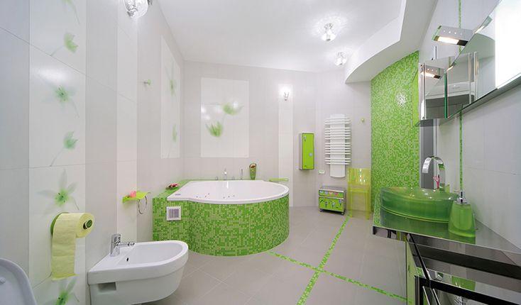 <p>Автор проекта: Светлана Байдюк </p> <p>Просторная ванная комната выглядит ярко и эффектно. За счет отделок. Большинство стен и потолок выкрашены в белый цвет, а одна стена и бортик джакузи отделан мозаикой цвета зеленого яблока. В белом окружении этот сочный зеленый выглядит великолепно!</p>