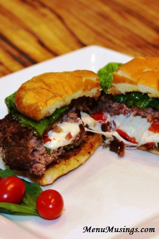 Caprese Stuffed Burgers - all my favorite flavors oozing out of the middle of the burger.  Yes!!!  Step-by-step photo tutorial included.