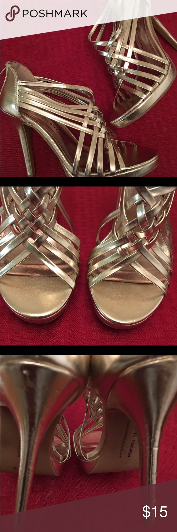 """Chinese Laundry gold strappy heels Chinese Laundry """"Fiesta"""" pale gold metallic strappy heels / sandals. Zip closure in back. 4 1/2 inch heel. Super awesome! Have been worn but still have lots of life left in them. ***please note scuffs, original box not included. Smoke free and pet free environment. Chinese Laundry Shoes Heels"""