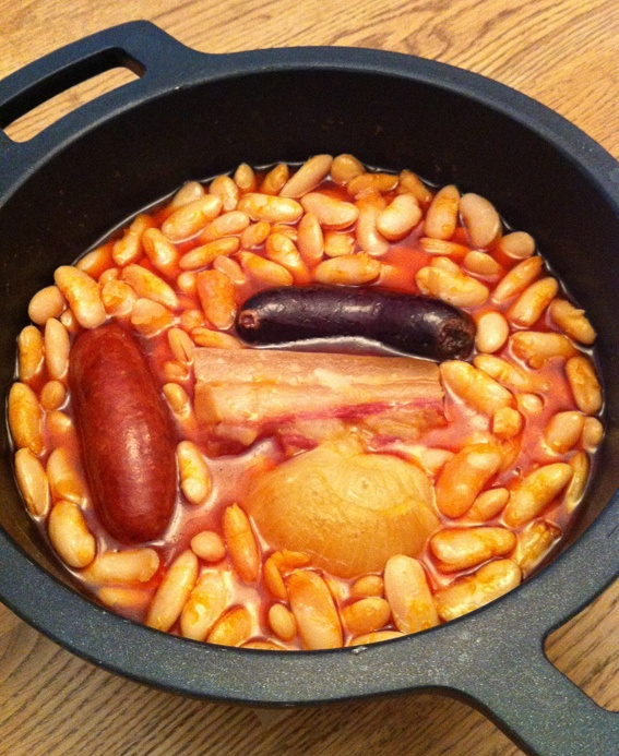 Fabada asturiana - National dish of Spain. Stew of white beans, bacon, chorizo, black pudding and saffron.