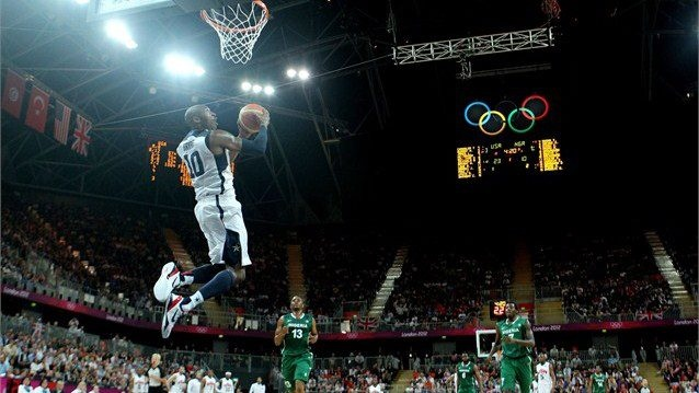 Kobe Bryant of the United States dunks against Nigeria in the first half during the men's Basketball preliminary round match on Day 6 of the London Olympics 2012.