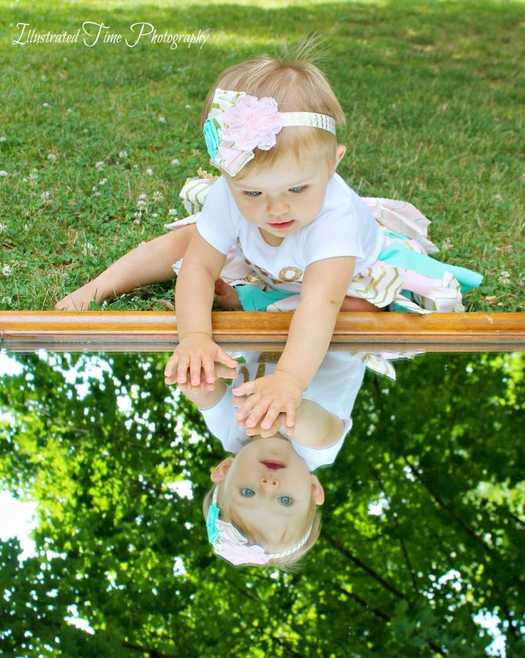 Baby girl first birthday photo session. Mirror reflection photography. Baby photography. Family photography. Outdoor photography. Babys first photo shoot