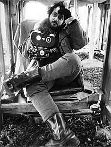 Stanley Kubrick taking a break, waiting for the rain to stop, during filming of A Clockwork Orange