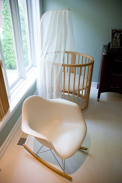 I think I adore this stokke mini crib. It can be sized-up in various stages, the max fitting a 10 year old. But I love the simple design and the solid wood.
