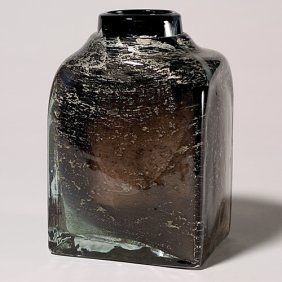 """Bold Benny Motzfeldt vase in square form with silvery metallic inclusions and random bubbles that float above a blackened body with a ghostly image. Height 8 1/4 inches. Engraved """"BM 70."""" Nelson Collection."""