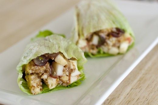Sweet Summer Wrap - Fuji Apple, red grapes, tempeh, almond butter, and honey rolled up into an iceberg lettuce wrap!
