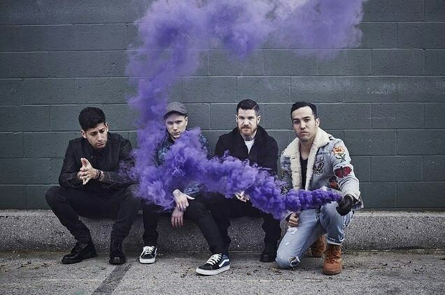 Patrick looks like he is trying his very hardest not to breath in the purple smoke...LOL
