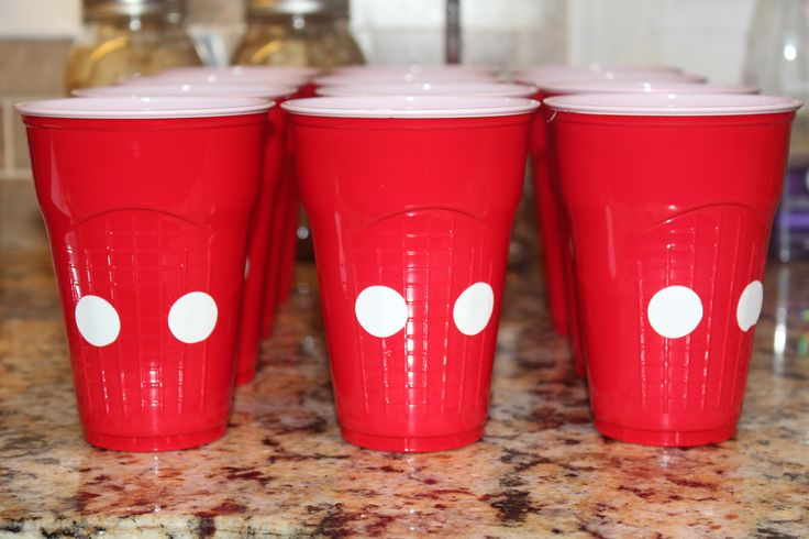 You could get those white stickers often used for garage sales and add them to the cups to easily carry the Mickey theme.
