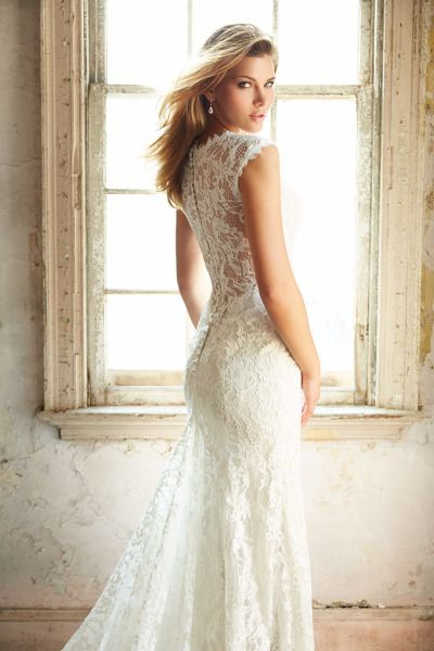 Drop dead gorgeous lace gown: http://www.stylemepretty.com/2015/01/19/gorgeous-gowns-from-allure-bridals-an-allure-love-stories-giveaway/