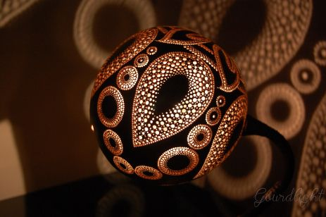 Lampshade is made of Indonesian gourd. The pattern includes 6 leaves, 6 drops and 37 circles. All of that shapes are filled up with perforations in few different diameters. Every hole was manually …