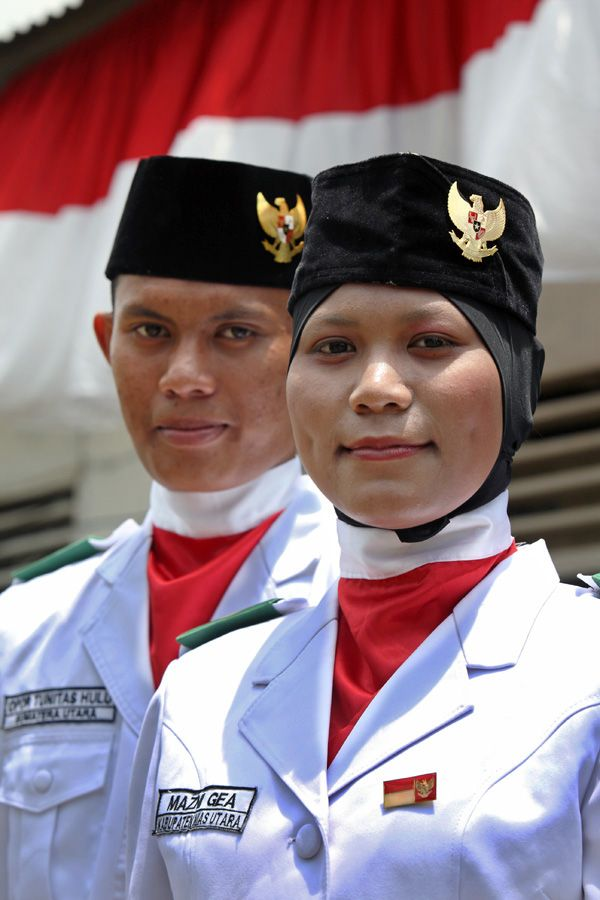 Every year on the 17th of August (Indonesia's National Day) a flag raising ceremony is held called Paskibraka. The selection to join Pasibraka is very tough and takes over a month. This couple were selected to represent North Nias nationally  in 2013. North Nias Regency, Nias Island, Indonesia. Photo by Bjorn Svensson. www.northniastourism.com