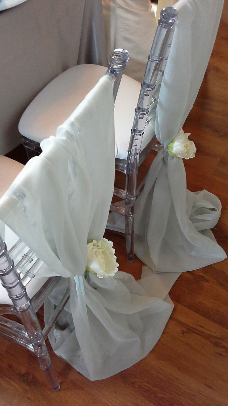 simple chair treatment with voile and silk peony flower; design by Davis Floral Creations