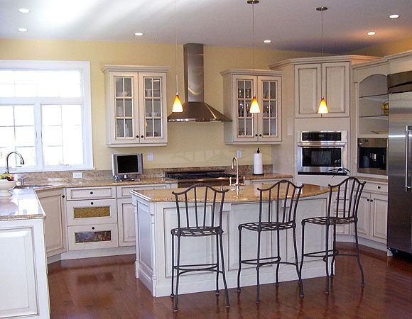 Dura supreme kitchen cabinetry shown with chapel hill classic cabinet door style with maple in - Antique white cabinets with black glaze ...