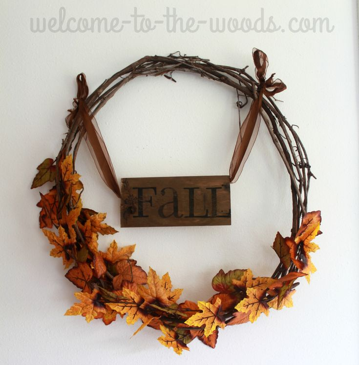 Pallet wood fall sign hung on a leaf grapevine wreath. Decor ideas 2016.