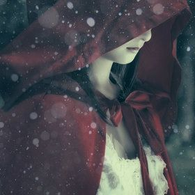 A mysterious figure enters town in the middle of a storm.  Cloaked in red the small pale woman shows neither fear nor hesitation.  Ivory skin, Dark brown hair.  This fragile beauty is clothed constantly in white or red.