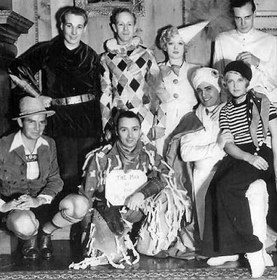Leslie Howard attends a costume ball at the Hearst Castle with Douglass Montgomery (his right), Marion Davies (his left); bottom row: Bruce Cabot, George K. Arthur, Ramon Navarro and Eileen Perry, 1931