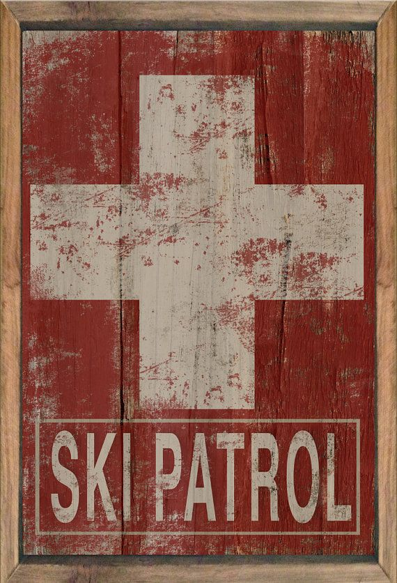 Wooden ski patrol sign framed out in reclaimed wood. Distressed styled art on paper applied to wood then sealed twice for protection. Approx.