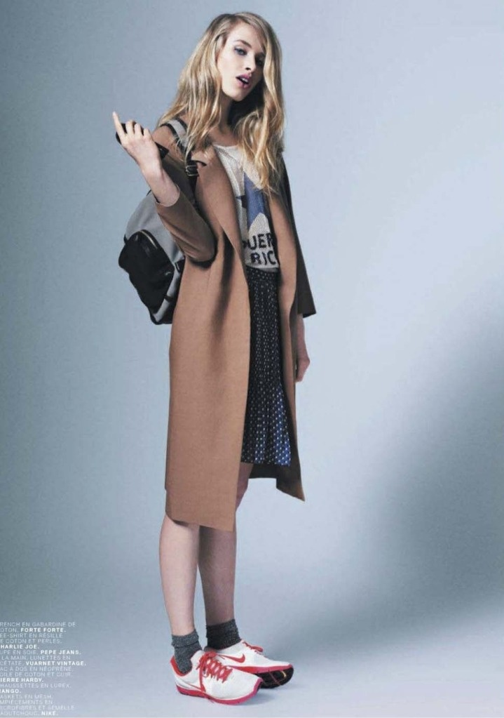 love the cheeky attitude.  Camel coats and sneaks forever! image via Jalouse
