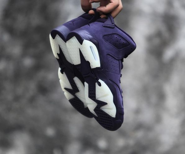 The Air Jordan 6 GS Purple Dynasty is showcased in a detailed look. Find it at select Jordan Brand stores on Dec. 30th.