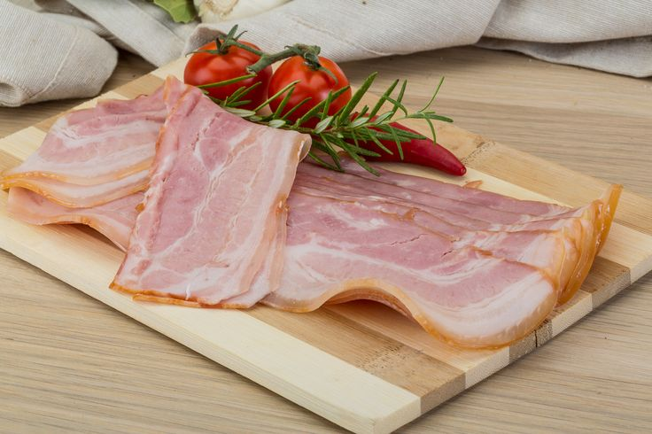 You can stop bacon from curling while cooking, if you immerse it in some cold water, before frying. Pat dry with paper towels before you put it in the pan!