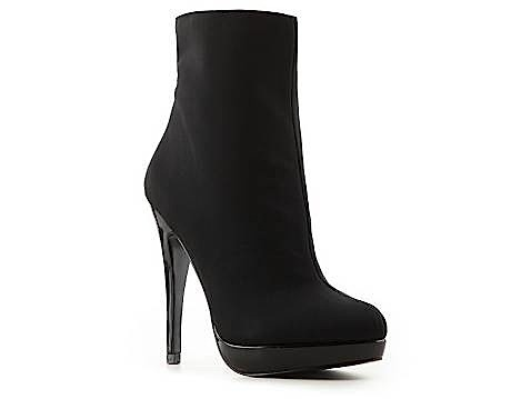 Charlize Theron jet sets with Jackson in style - The Avenger Bootie from Charles by Charles David ($69.95)Booty 6995