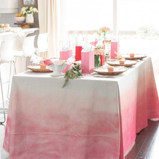 learn how to create this pink ombre tablecloth using a drop cloth and spray paint