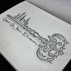 I just love the idea of the key with the little things being buildings. I love Chicago-so I would want to get part of the Chicago skyline including the Sears Tower as a part of the skyline. I would get it on the inside of my upper arm.