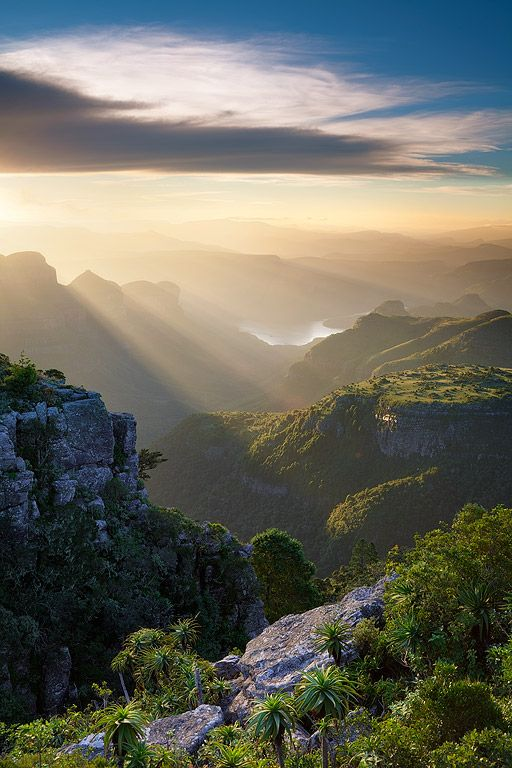 landscape photograph of dramatic sunset light over the blyde river canyon as seen from mariepskop in mpumalanga, south africa