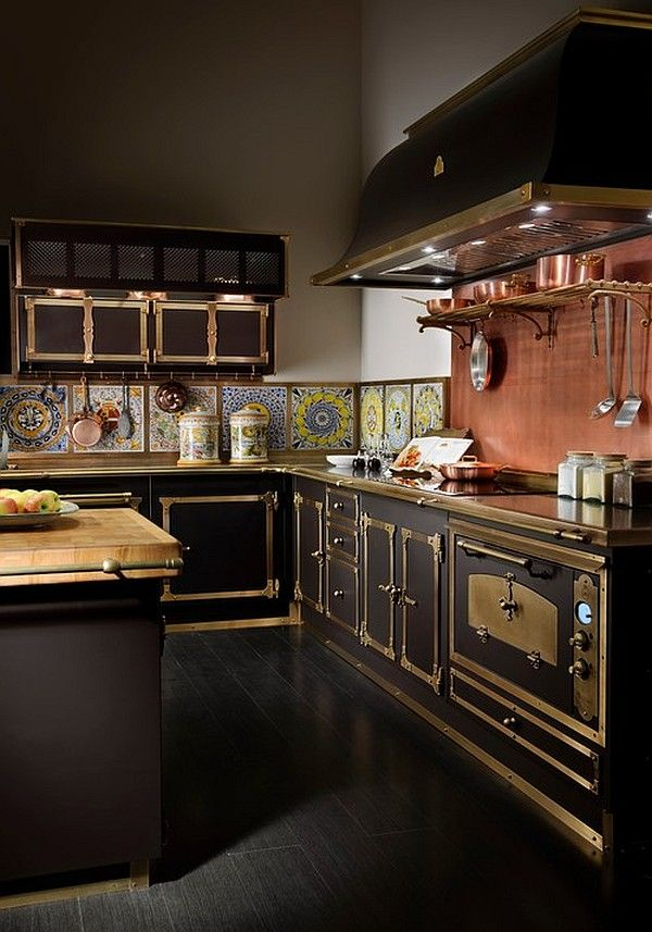 Think of the Victorian train stations and their steel structures with elegant and elaborate decorative details, certificates of both technology and manufacture art. Some of that fascinating mix can be found in this kitchen  hardware and fine metallic details turn it into an elegant cooking laboratory.