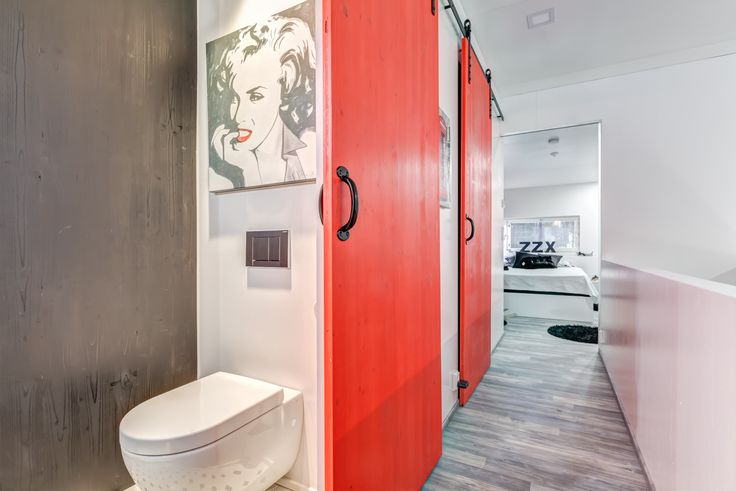My Hollywood toilet and barn doors in my house in Espoo, Finland