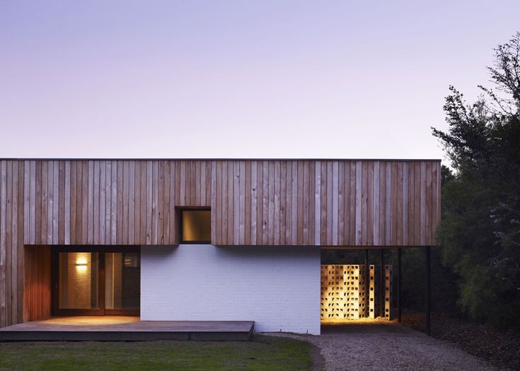 Australian office Kennedy Nolan Architects used recycled bricks, concrete and rough-sawn timber to construct this courtyard house near the beach in Melbourne.