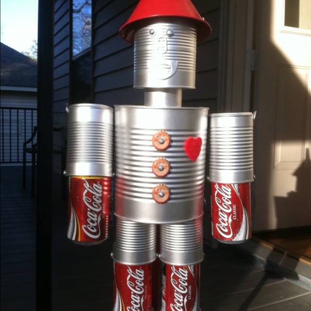 Mr.Tin Man - made with coffee can, veggy cans, neck is tuna can and sardine cans for the feet.