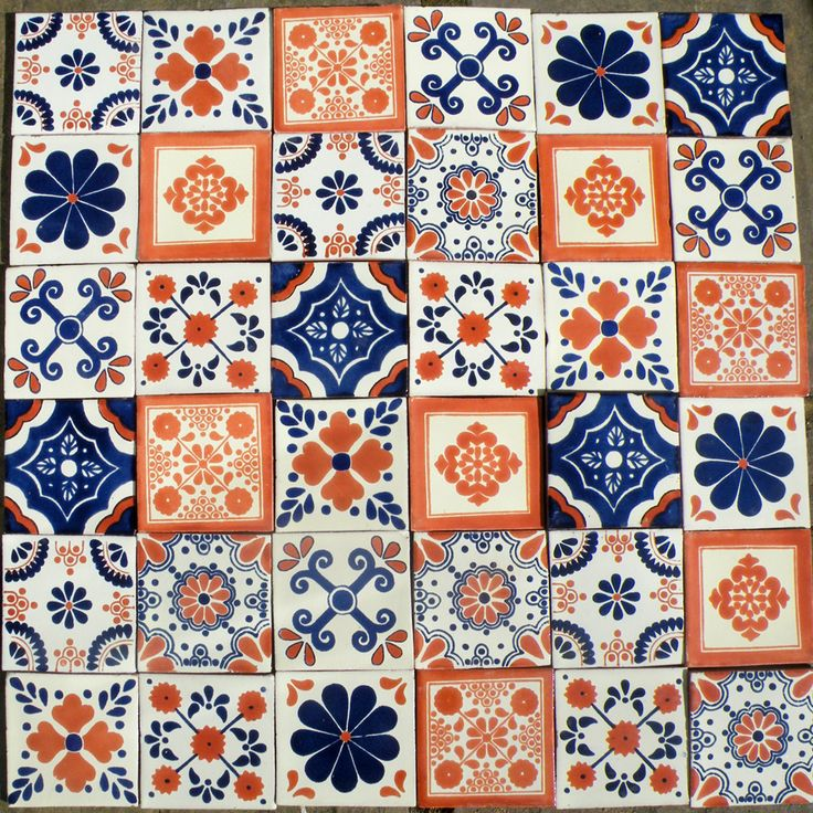 Blue and terracotta patchwork- The variety of patterns, colours and shapes, all with just Blue, White, Orange