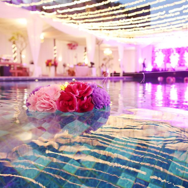 Pink And Purple Flowers Float In The Pool Pink Wedding