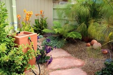 Rain Barrel MagicPhoto 4 of 18Blend it in.  If you'd rather your barrel blend in, tuck it into the corner and surround it with soft plantings. Repeating the terra cotta elements in the rest of the space provides design continuity