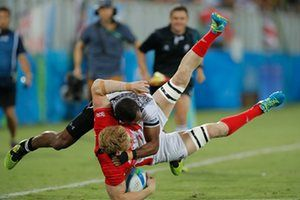 At Rio 2016, Fijian Apisai Domolailai tackles Sam Cross of Great Britain in the rugby sevens final at Deodoro, won by Fiji